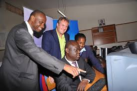 KENET Executive Director Meoli Karshoda, Vice Chairman Richard Bell,Nairobi County Education Member Christopher Khaemba test out the Fiber to schools project at Moi Girls
