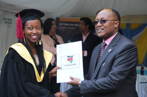One of the graduates with Principal Secretary Ministry of ICT, Joseph Tiampati