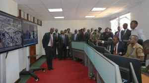 President Uhuru Kenyatta, his Deputy President William Ruto, and Cabinet Secretary Joseph Nkaissery when they toured the National Police Service headquarters to asses the progress in the implementation of a secure communication and surveillance system.