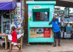 Dauda Musa,(standing) who runs a mobile money transfer business in Accra, and as the number of people with mobile phones has grown over the past few years, more people are using his service for business or to share money with friends and family.