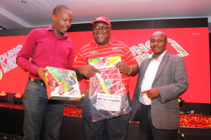 Mr Felix Kyengo, GOtv Kenya General Manager (right), Phillip Wahome, MultiChoice Kenya Corporate Communications Manager (left) and Charles Bukeko aka Papa Shirandula, GOtv brand ambassador and also popular Kenyan actor showcase the GOtv decoder package during the launch of GOtv's 'Dunga Milli' promotion at Royal Orchid Hotel in Nairobi.