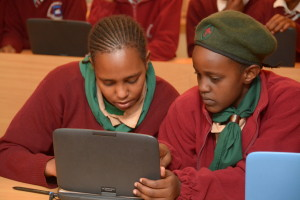 Students admiring a model classromm laptop that was unveiled by kenya private school association (KPSA) and Intel at an event held recently