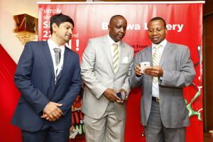 from left Arindan banerjee,technical,Incharge of lottery software,Dr.Solomon Lenengwesi,Executive chairman,Halifax Kenya,Josiah Muia Head of corporate banking(AG)