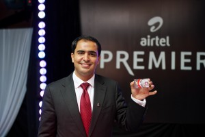 Airtel Kenya CEO Adil El Youssefi displays the Airtel Money Premier VISA card