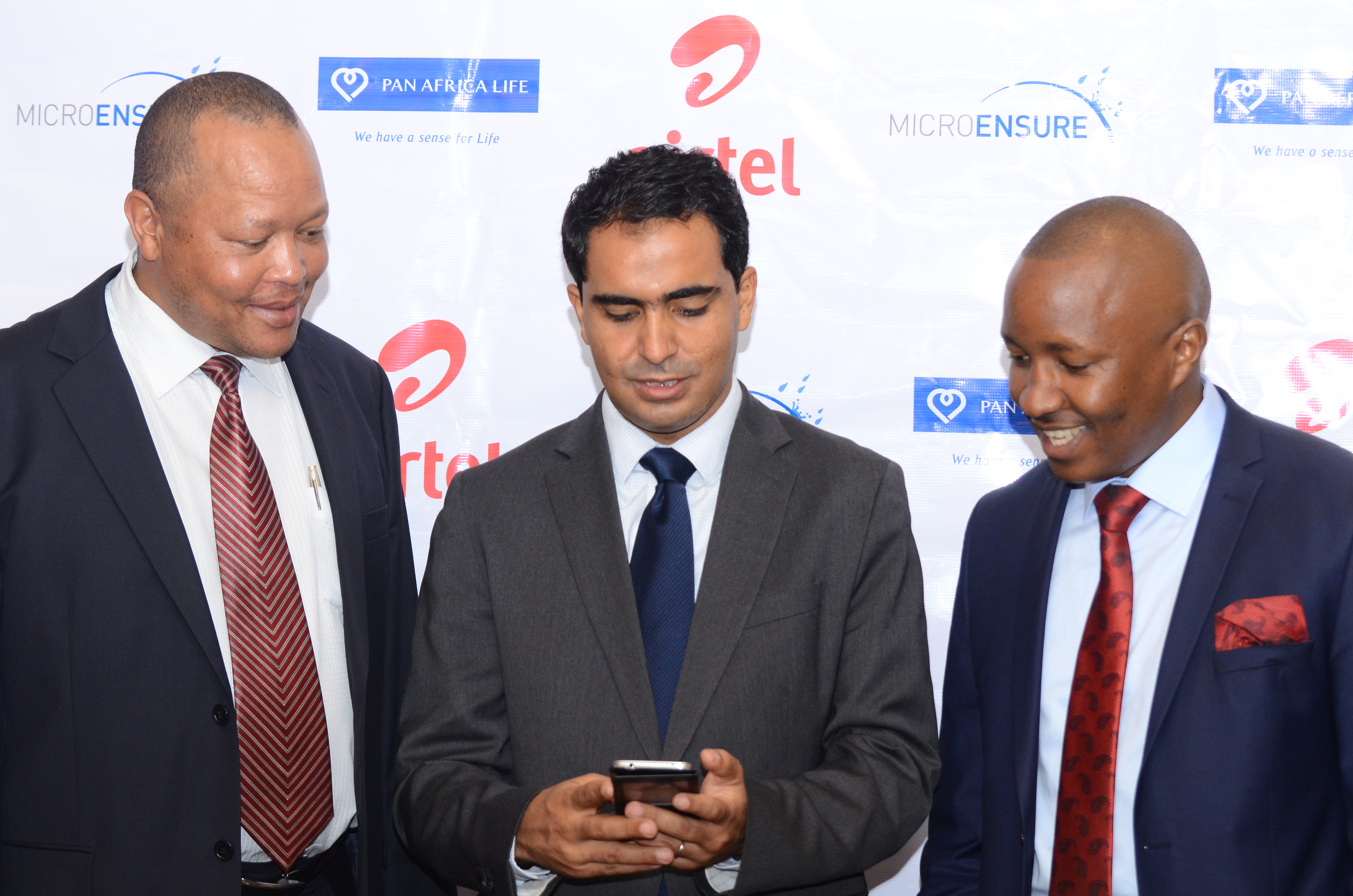 Pan Africa Life Insurance CEO Stephen Kamanda, Airtel Kenya CEO Adil El Youssefi & MicroEnsure Regional Director Kiereini Kirika during the official launch of Airtel Insurance