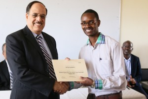 Third-year-Computer-Technology-student-Peter-Kabonyi-right-receives-an-IMB-Academic-Certificate-from-Dr.-Attia-300x200