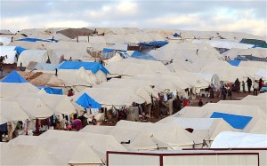 Families at a makeshift camp for displaced Syrian refugees, set up along the Turkish border close to the village of Atme.