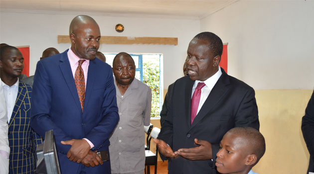 Education Cabinet Secretary Dr. Fred Matiang'i and Airtel Kenya Corporate Communications and CSR Director Dick Omondi during the launch of Airtel FREE Internet for Schools program at Kenyoro Mix Sec School.