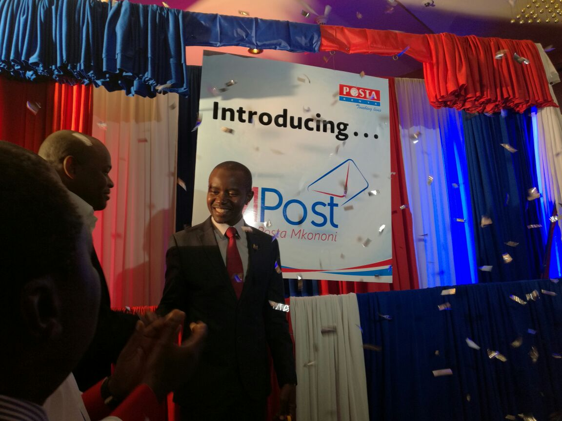 ICT Cabinet Secretary Joe Mucheru during the launch of 'M-Post Mkononi'. The new service will allow customers to receive notifications about their mails and parcels via their mobile phones.
