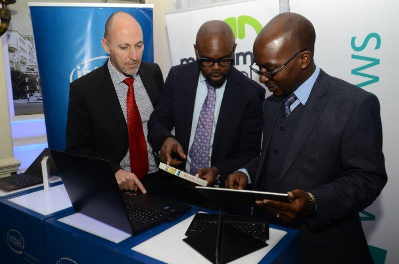 on the Left INTEL East Africa General Manager, Danie Steyn listens as Microsoft's General Manager for East Africa- Kunle Awosika explains the Microsoft offerings to Mwalimu National Sacco CEO- Robert Shibutse.