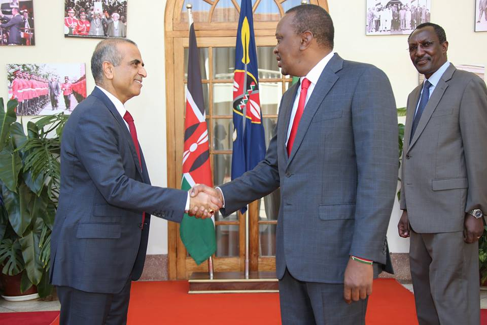 President Uhuru Kenyatta with the Bharti Enterprises chairman Sunil B. Mittal, when he called on him at State House, Nairobi, February 16, 2016. Looking on is Airtel Kenya chairman Dr. Titus Naikuni.