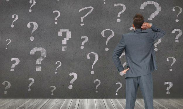 pensive-man-with-question-marks-background_1134-620-626x375